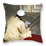 A Pious Devotee Reading The Quran Inside The Jama Masjid In Delhi Throw Pillow