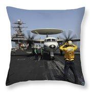 A Plane Director Guides An E-2c Hawkeye Throw Pillow