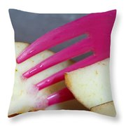 A Plastic Fork Being Used To Cut Into A Piece Of Cut Apple Pieces Throw Pillow