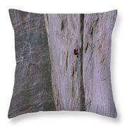 A Rock Climber Clings To An Overhang Throw Pillow