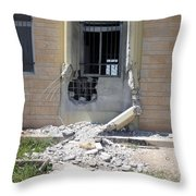 A Rocket Propelled Grenade Damaged This Throw Pillow
