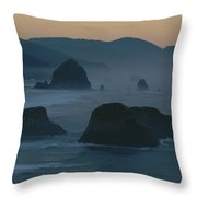 A Rocky Shoreline Is Silhouetted Throw Pillow