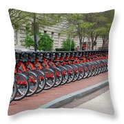 A Row Of Red Bikes Throw Pillow