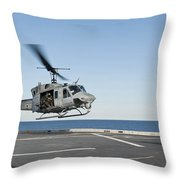 A Sailor Directs A Uh-1n Huey Throw Pillow