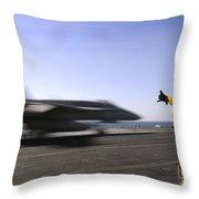 A Sailor Ensures An Fa-18c Hornet Throw Pillow by Stocktrek Images