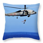 A Search And Rescue Swimmer Is Lowered Throw Pillow