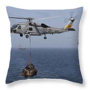A Sh-60j Seahawk Transfers Cargo Throw Pillow