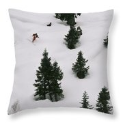 A Skier Makes His Way Down A Hill Throw Pillow