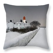 A Snow Covered Fence With A Lighthouse Throw Pillow by John Short