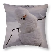 A Snowman Sitting In The Snow Throw Pillow