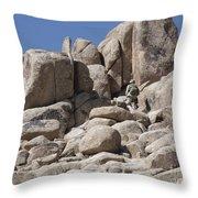 A Soldier Climbs A Mountain Throw Pillow