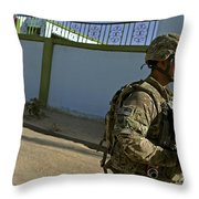 A Soldier Patrols The Streets Of Qalat Throw Pillow