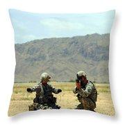 A Soldier Prepares A Drag Line While An Throw Pillow