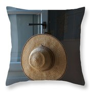 A Sun Hat Hangs On The Door Of A Tuscan Throw Pillow