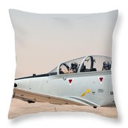 A T-6 Texan Flying Over Camp Speicher Throw Pillow