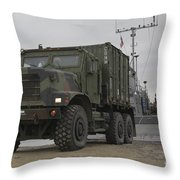 A Tactical Vehicle Is Off-loaded Throw Pillow