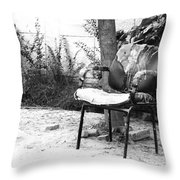 A Torn Chair Throw Pillow
