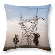 A Transmission Tower Carrying Electric Lines In The Countryside Throw Pillow