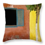 A Tree Outside A Colorful Building And Throw Pillow