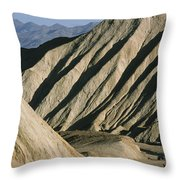 A Truck Is Dwarfed By Eroded Desert Throw Pillow