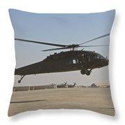 A Uh-60 Black Hawk Landing Throw Pillow
