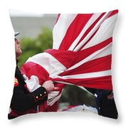 A United States Marine Takes Throw Pillow