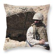A U.s. Marine Communicates With Close Throw Pillow