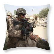 A U.s. Marine Gives A Piece Of Candy Throw Pillow