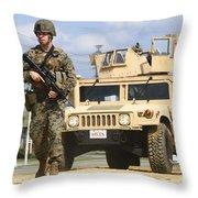A U.s. Marine Guides A Humvee Throw Pillow