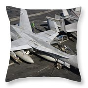A Us Navy Fa-18c Hornet Parked Throw Pillow