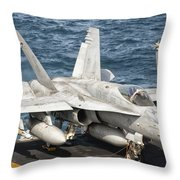 A Us Navy Fa-18c Hornet Tied Throw Pillow by Giovanni Colla