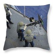 A U.s. Sailor Fires A .50-caliber M2hb Throw Pillow