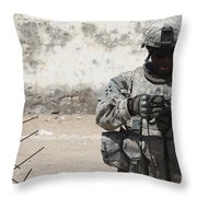 A U.s. Soldier Tests A Tactical Throw Pillow