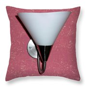 A Wall Mounted Lamp Set Against A Pink Printed Wall Color Throw Pillow