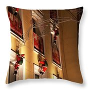 A Wall Of Sneaky Santas Throw Pillow