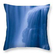 A Waterfall Splashes Off Of A Large Throw Pillow
