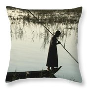 A Woman Stands At The End Of A Rowboat Throw Pillow