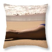 A Woman Sunbathes On The Beach Throw Pillow