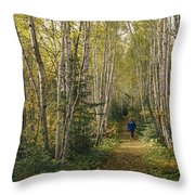 A Woman Walks Down A Birch Tree-lined Throw Pillow
