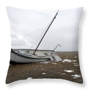 A Wooden Sailboat Is Beached Throw Pillow