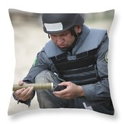 Afghan Police Student Prepares Throw Pillow