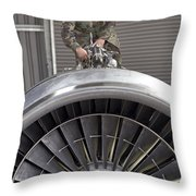 Airman Checks Components Atop A C-5 Throw Pillow