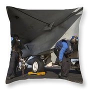 Airmen Chain Down An Fa-18e Super Throw Pillow