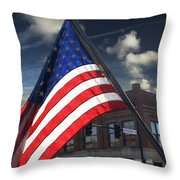 American Flag Flowing In Urban Landscape Throw Pillow