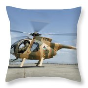 An Afghan Air Force Md-530f Helicopter Throw Pillow