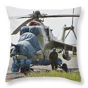 An Afghan Army Soldier Guards A Mi-35 Throw Pillow