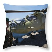 An Afghan Army Soldier Guards An Mi-35 Throw Pillow