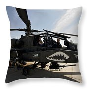 An Ah-64d Apache Helicopter Parked Throw Pillow
