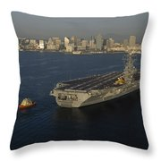 An Aircraft Carrier With The Skyline Throw Pillow
