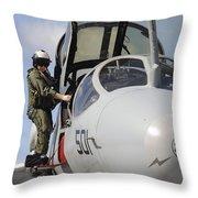 An Airman Makes A Final Look Over An Throw Pillow